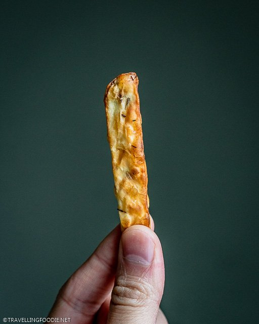 Holding a piece of crispy french fry