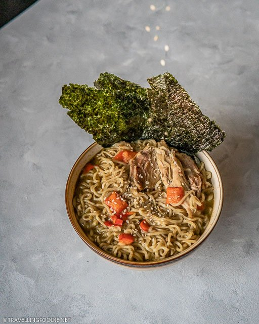 Adding sesame seeds toppings to Thai Curry Chicken Noodle Soup from Instant Pot
