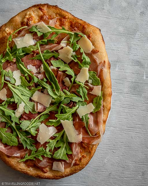 Flatlay of Italian Pizza with Prosciutto di Parma, Arugula and Grana Padano Cheese