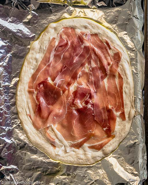Raw Pizza Dough topped with Prosciutto di Parma