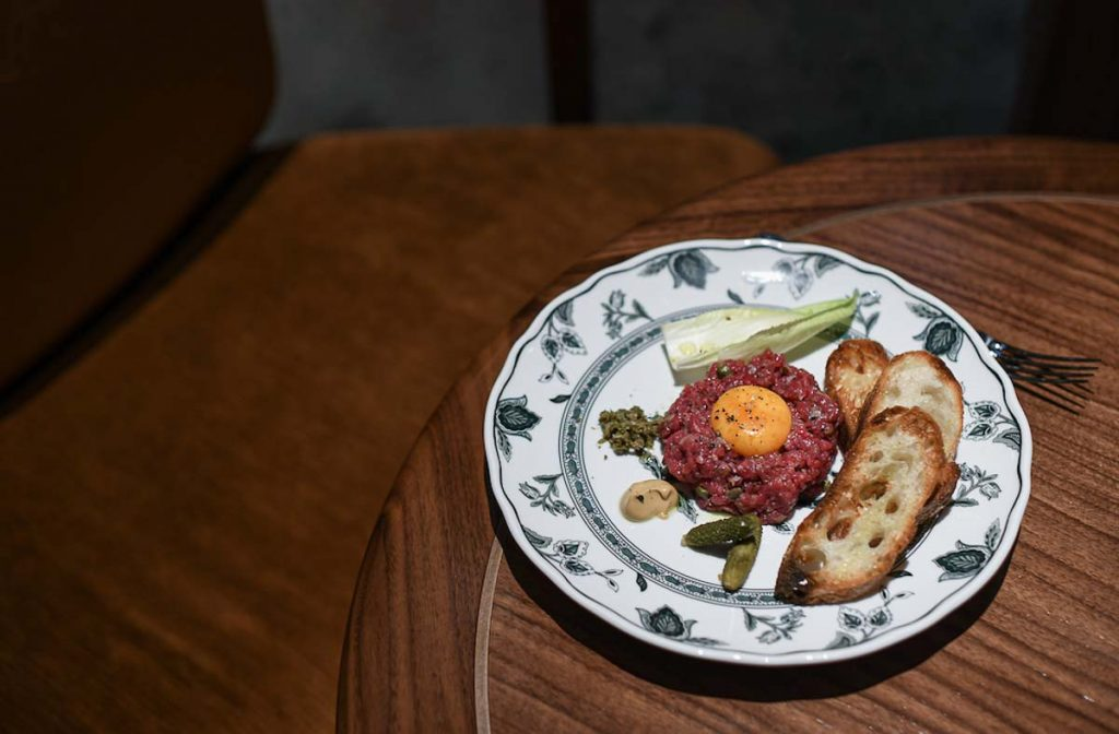 Toronto Signature Recipes: REIGN Restaurant Beef Tartare on table at Fairmont Royal York Toronto