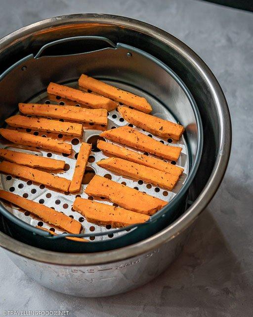Raw Sweet Potato Fries on Air Fryer Basket of Instant Pot Duo Crisp