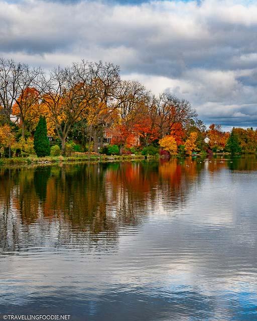 Fall foliage reflections at Lake Victoria along Avon River in Stratford, Ontario