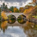 Ontario's oldest double-arch stone bridge during Fall at the Shakespearean Gardens in Stratford