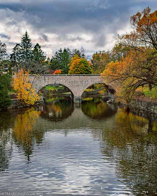 Ontario's oldest double-arch stone bridge at the Shakespearean Gardens in Stratford in Fall
