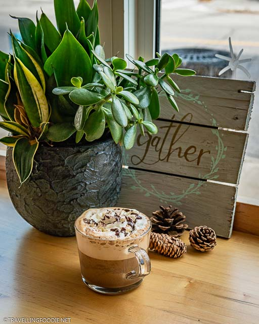 Double Mocha with plants and sign at The Livery Yard in Stratford, Ontario