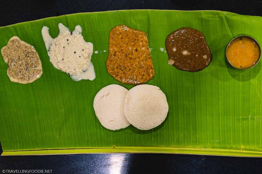 Idli with chutneys and sauces at Murugan Idli Shop in Madurai, India