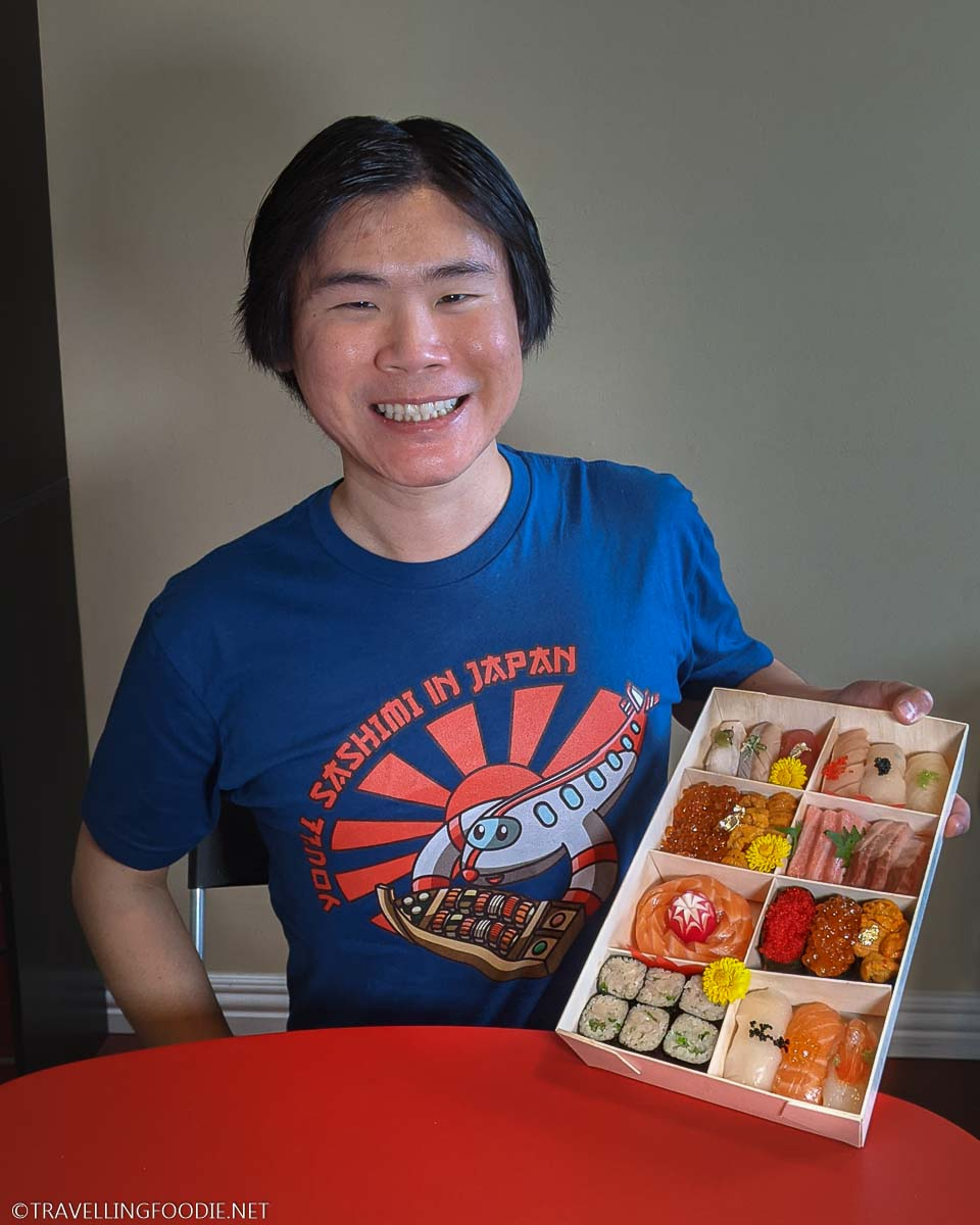 Travelling Foodie Raymond Cua wearing You'll Sashimi in Japan blue shirt holding Rain Izakaya Moriawase Box