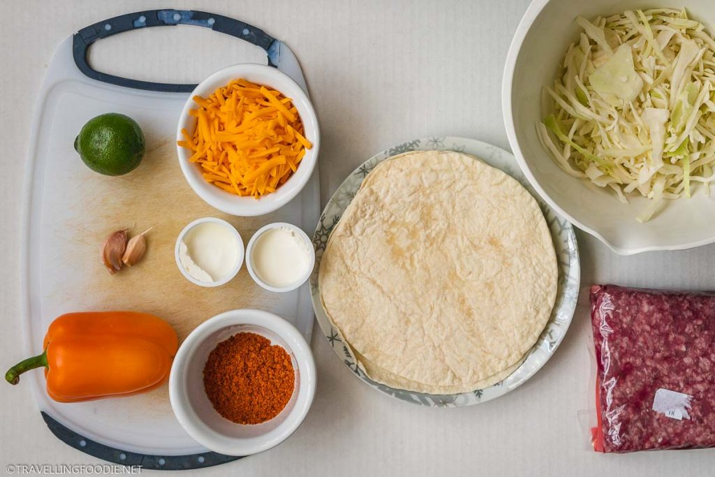 Tortilla, Cheese, Cabbage, Ground Beef, Sour Cream, Lime, Pepper, Garlic, Taco Seasoning