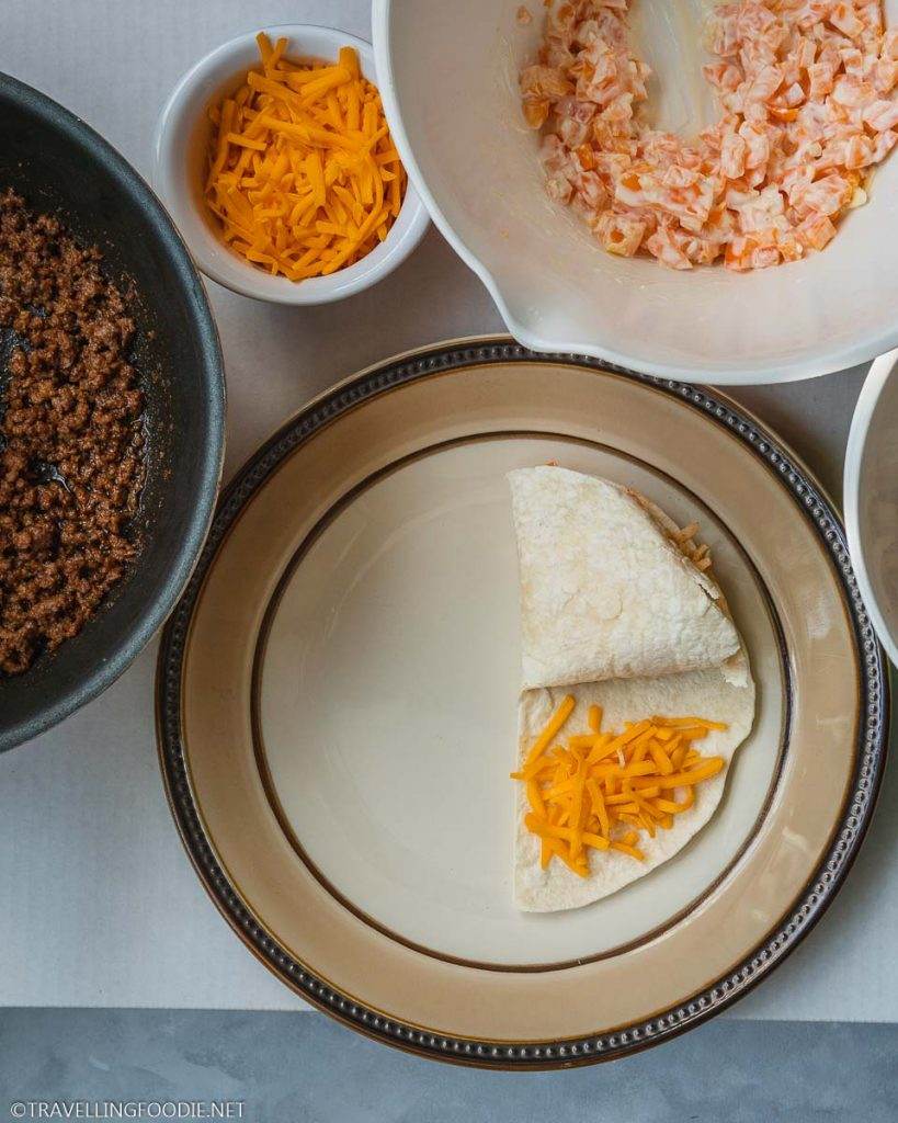Ground Beef and Cheese Wraps with two quarters folded for TikTok tortilla hack