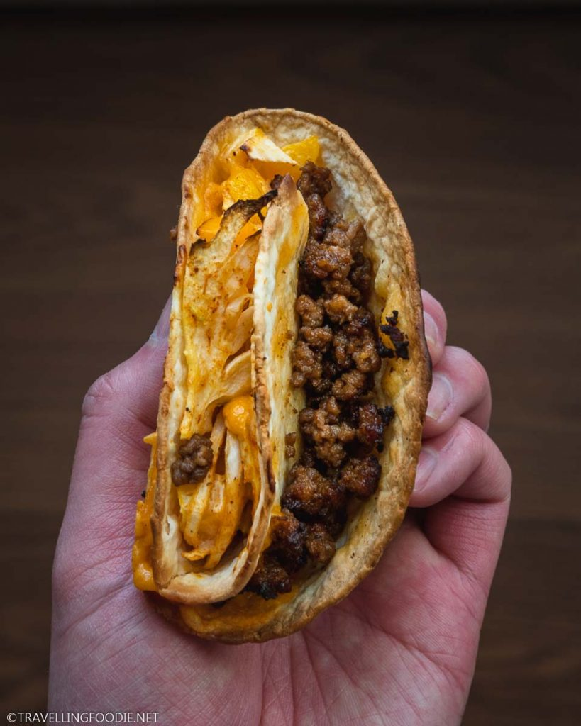 Holding an Air Fryer Beef and Cheese Crunch Wrap