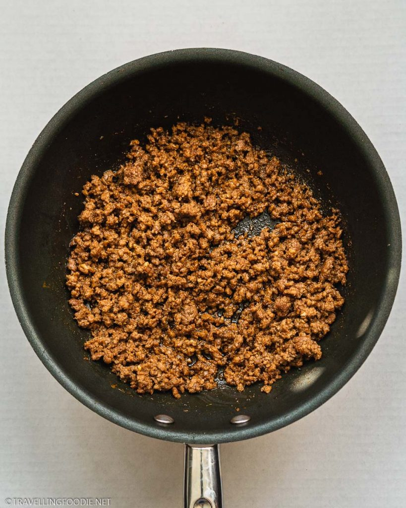 A pan of cooked seasoned ground beef