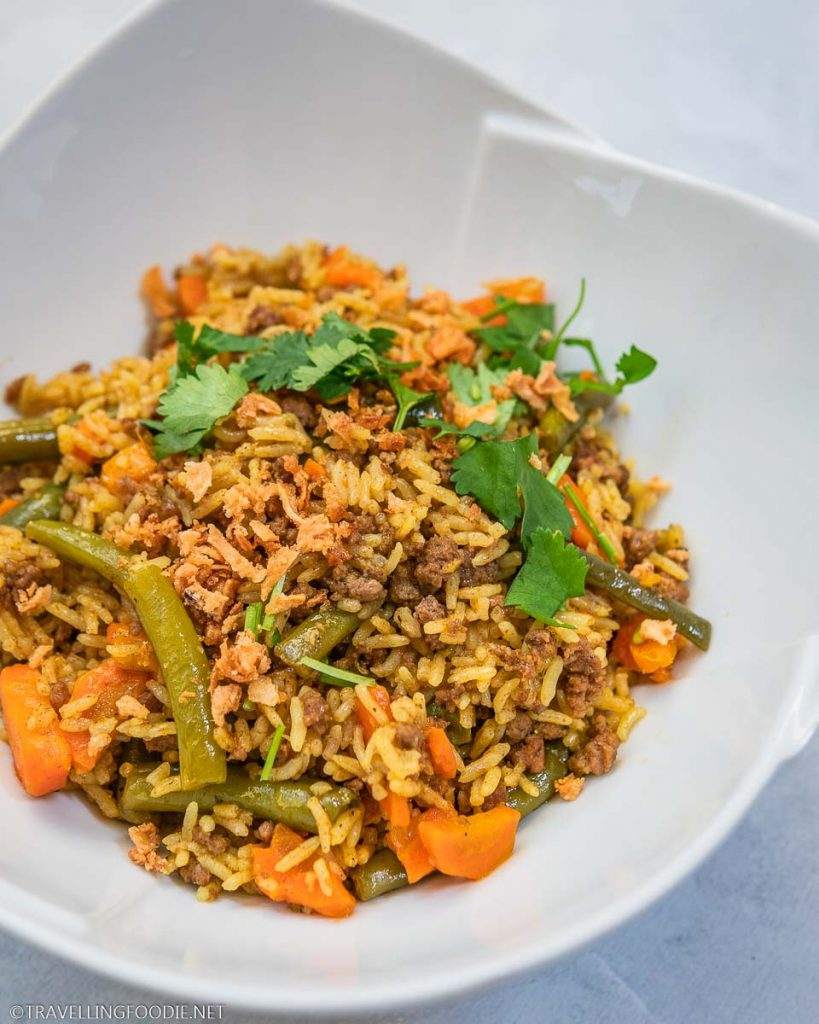Pressure Cooker Beef Biryani garnished with cilantro and crispy shallots
