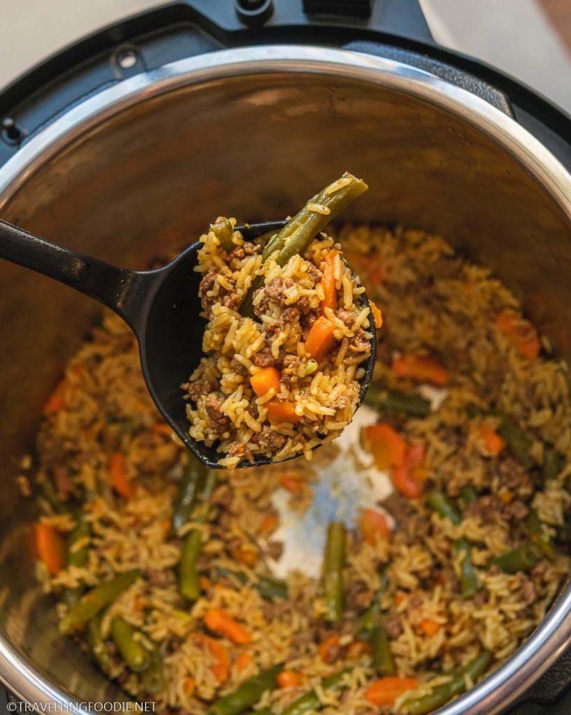 A scoop of Beef Biryani from the Instant Pot Duo Crisp
