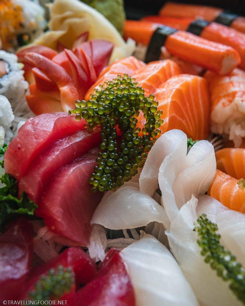 Tuna and Salmon Sashimi topped with Sea Grapes